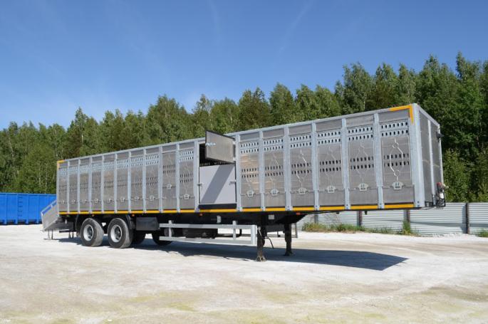 Купить универсальный полуприцеп ТОНАР для перевозки КРС и свиней, 2 оси.